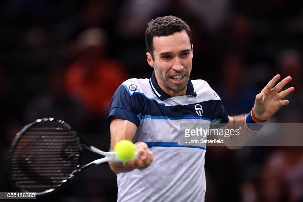 Mikhail Kukushkin of Kazakhstan plays a forehand in his first round match against Pierre-Hugues Herbert of France during Day 2 of the Rolex Paris...