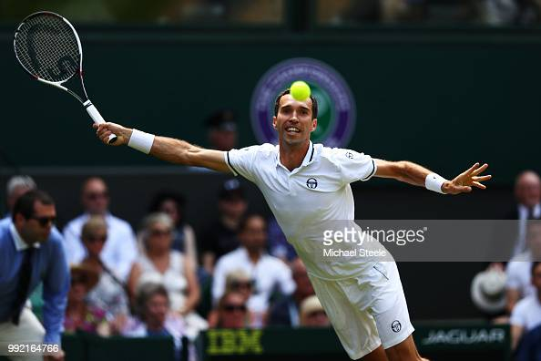 Mikhail Kukushkin of Kazakhstan returns a shot against Rafael Nadal of Spain during their Men's Singles second round match on day four of the...