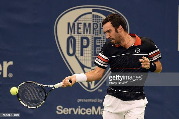 Mikhail Kukushkin of Kazakhstan returns a shot to Kei Nishikori of Japan during their quarterfinal singles match on Day 5 of the Memphis Open at the...