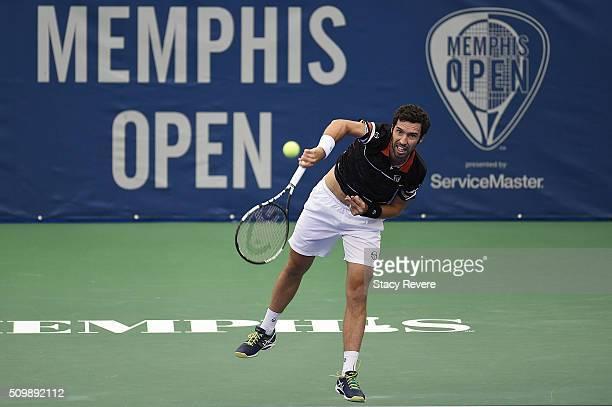 Mikhail Kukushkin of Kazakhstan serves to Kei Nishikori of Japan during their quarterfinal singles match on Day 5 of the Memphis Open at the Racquet...