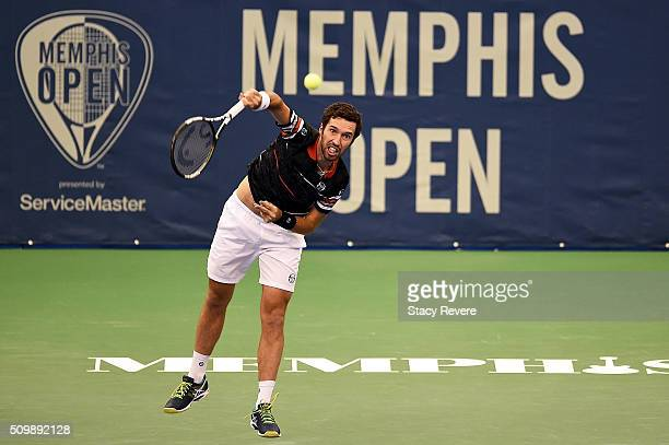 Mikhail Kukushkin of Kazakhstan serves to Kei Nishikori of Japan during their quarterfinal singles match on Day 5 of the Memphis Open at the Racquet...