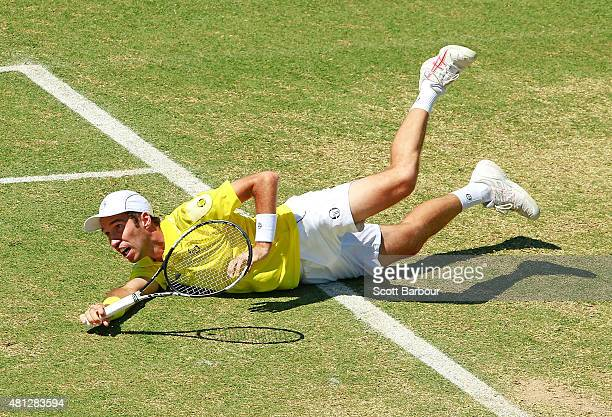 Mikhail Kukushkin of Kazakhstan slips as he plays a shot during the reverse singles match between Sam Groth of Australia and Mikhail Kukushkin of...