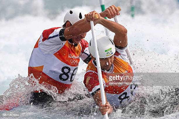 Mikhail Kuznetsov and Dmitry Larionov of Russia compete during the Men's Canoe Double Slalom heats on Day 3 of the Rio 2016 Olympic Games at the...
