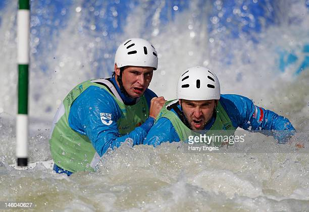 Mikhail Kuznetsov Dmitry Larionov compete in the Men's C2 semi final during the ICF Canoe Slalom World Cup at Cardiff International White Water on...