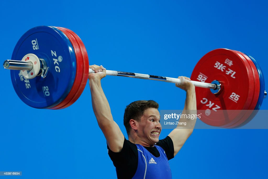 Mikhail Makeyev of Kazakhstan competes in the Men's 69kg Weightlifting on day three of the Nanjing 2014 Summer Youth Olympic Games at Nanjing International Expo Centre on August 19, 2014 in Nanjing, China.