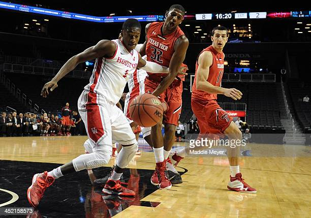 Mikhail McLean of the Houston Cougars and Jordan Tolbert of the Texas Tech Red Raiders battle for a loose ball during the fist half at Barclays...
