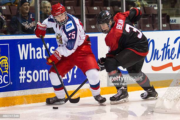 Mikhail Mesheryakov of Russia moves the puck against Jake Bean of Canada Black during the World Under17 Hockey Challenge on November 2 2014 at the...