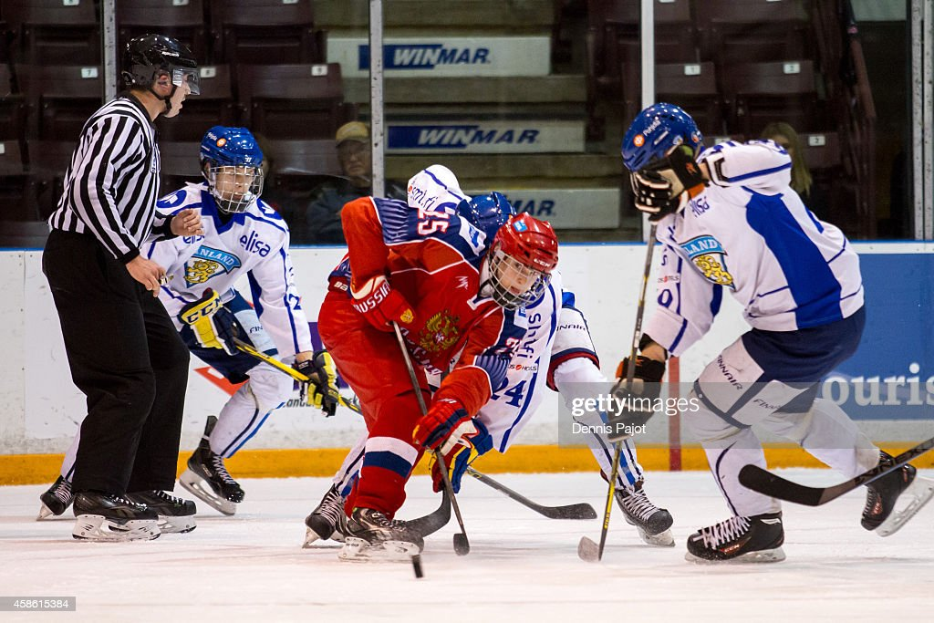 Mikhail Mesheryakov #25 of Russia moves the puck against Otto Somppi #24 of Finland during semifinals at the World Under-17 Hockey Challenge on November 7, 2014 at the RBC Centre in Sarnia, Ontario.