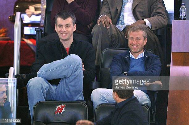 Mikhail Prokhorov and Roman Abramovich attend the Miami Heat vs New Jersey Nets Game at Prudential Center on October 31 2010 in Newark New Jersey