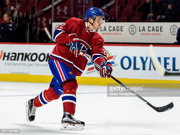 Mikhail Sergachev of the Montreal Canadiens takes a shot during the warmup prior to the NHL game against the Arizona Coyotes at the Bell Centre on...