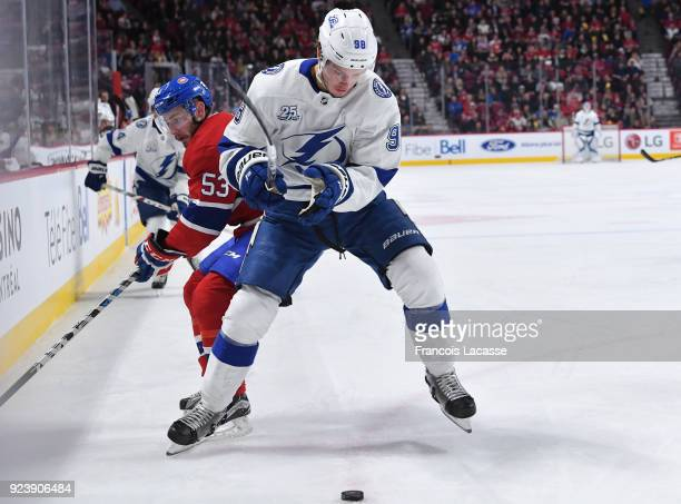 Mikhail Sergachev of the Tampa Bay Lightning battles for the puck against Victor Mete of the Montreal Canadiens in the NHL game at the Bell Centre on...