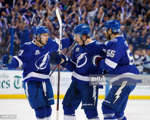 Mikhail Sergachev of the Tampa Bay Lightning celebrates his goal with teammates Anthony Cirelli and Braydon Coburn against the New Jersey Devils in...