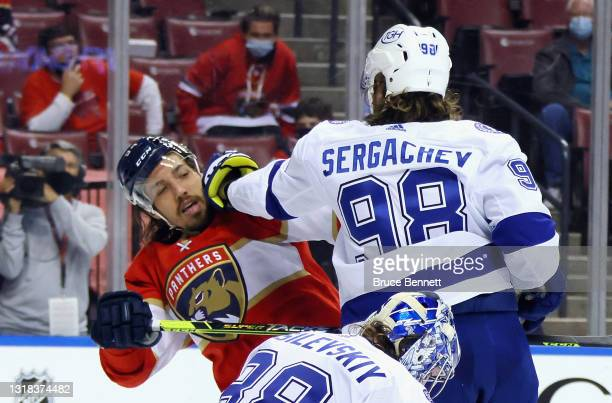 Mikhail Sergachev of the Tampa Bay Lightning gets the glove up on Ryan Lomberg of the Florida Panthers during the second period in Game One of the...