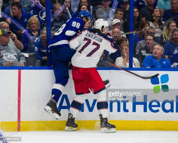 Mikhail Sergachev of the Tampa Bay Lightning is checked Josh Anderson of the Columbus Blue Jackets in Game Two of the Eastern Conference First Round...