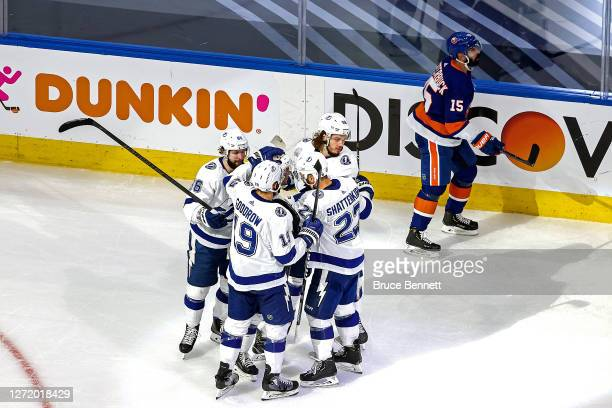 Mikhail Sergachev of the Tampa Bay Lightning is congratulated by his teammates after scoring a goal against the New York Islanders as Cal Clutterbuck...