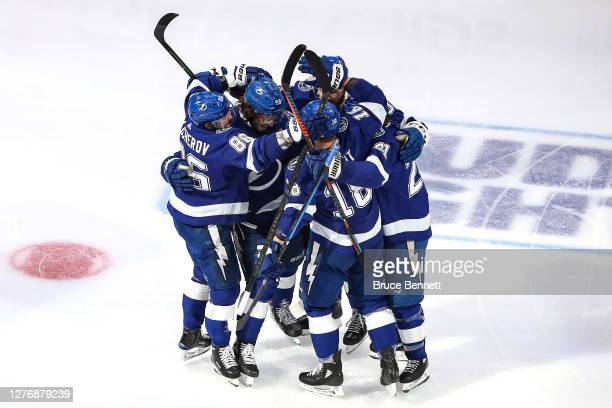 Mikhail Sergachev of the Tampa Bay Lightning is congratulated by his teammates after scoring a goal against the Dallas Stars during the third period...