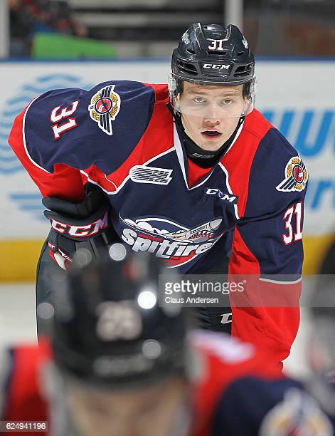 Mikhail Sergachev of the Windsor Spitfires gets set for a faceoff against the London Knights during an OHL game at Budweiser Gardens on November 20...