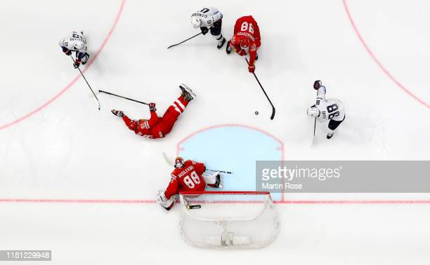 Mikhail Sergachyov of Russia challenges Patrick Kane of United States during the 2019 IIHF Ice Hockey World Championship Slovakia quarter final game...
