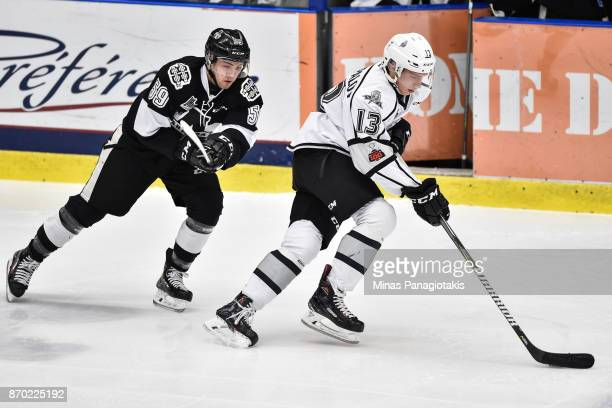 Mikhail Shestopalov of the Gatineau Olympiques skates the puck against CharlesAntoine Giguere of the BlainvilleBoisbriand Armada during the QMJHL...