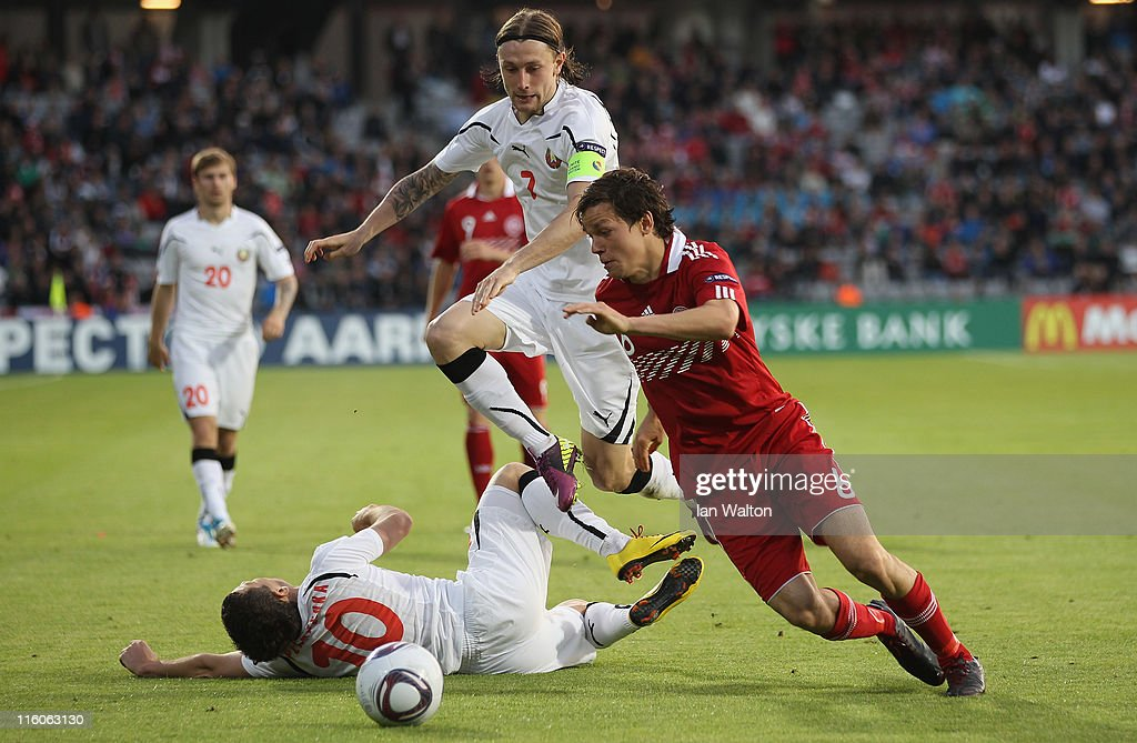 Mikhail Sivakov of Belarus in action against Yuri Ostroukh of Denmark (R) during the UEFA European Under-21 Championship Group A match between Denmark and Belarus at the Aarhus stadium on on June 14, 2011 in Aarhus, Denmark.