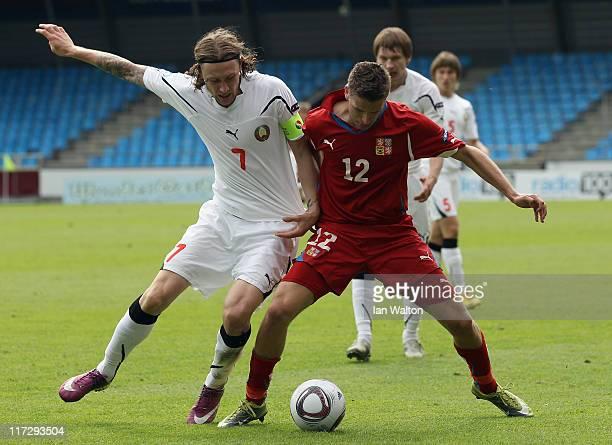 Mikhail Sivakov of Belarus tackles Jan Kovarik of Czech Republic during the UEFA European U21 Championship third place playoff match between Czech...
