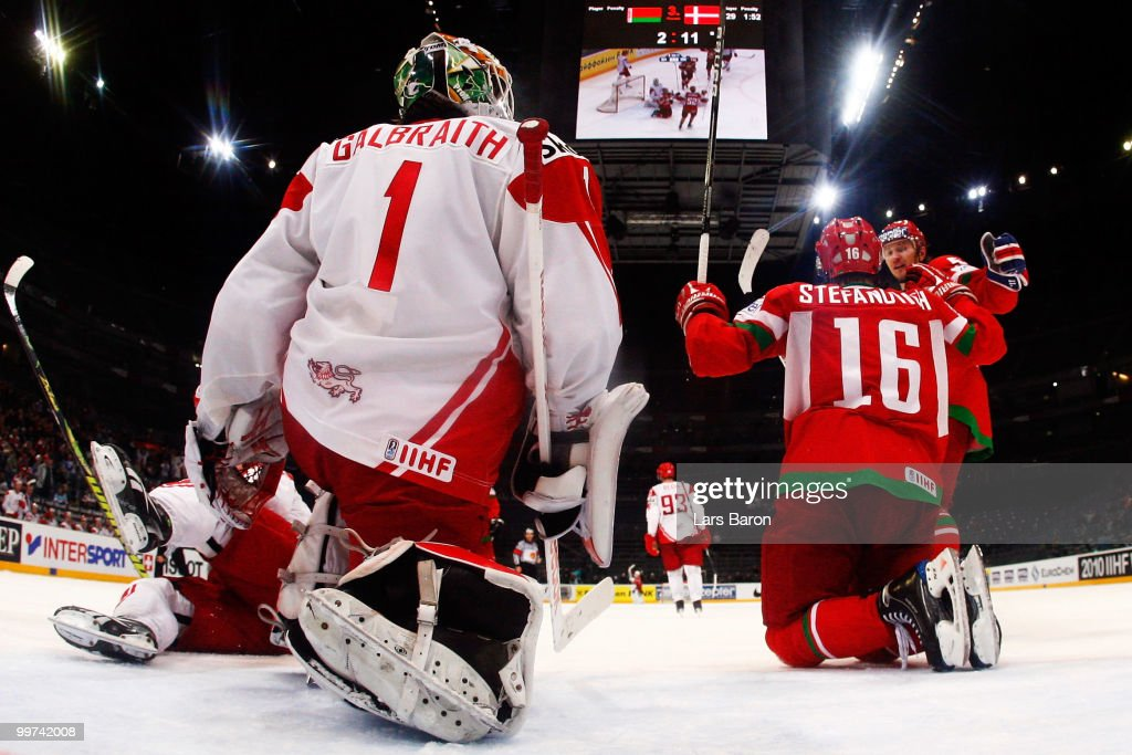 Mikhail Stefanovich of Belarus celebrates with team mates after scoring the winning goal past goaltender Patrick Galbraith of Denmark during the IIHF World Championship qualification round match between Belarus and Denmark at Lanxess Arena on May 17, 2010 in Cologne, Germany.