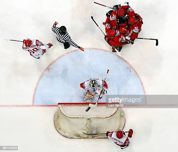 Mikhail Stefanovich of Belarus celebrates with team mates after scoring the winning goal past goaltender Patrick Galbraith of Denmark during the IIHF...