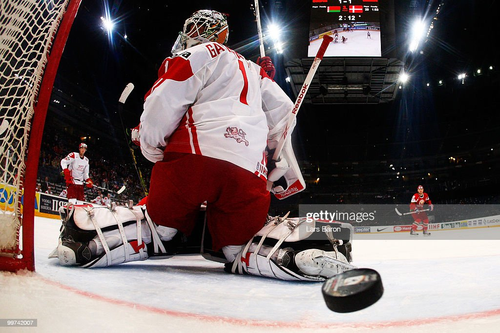 Mikhail Stefanovich of Belarus scores the winning goal past goaltender Patrick Galbraith of Denmark during the IIHF World Championship qualification round match between Belarus and Denmark at Lanxess Arena on May 17, 2010 in Cologne, Germany.