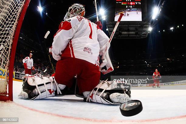 Mikhail Stefanovich of Belarus scores the winning goal past goaltender Patrick Galbraith of Denmark during the IIHF World Championship qualification...
