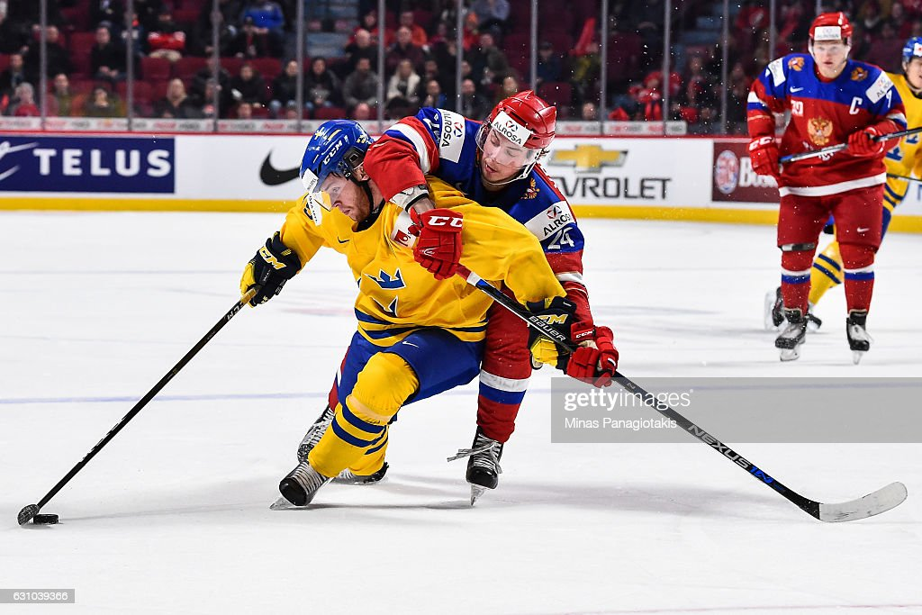 Mikhail Vorobyev #24 of Team Russia challenges Sebastian Ohlsson #25 of Team Sweden during the 2017 IIHF World Junior Championship bronze medal game at the Bell Centre on January 5, 2017 in Montreal, Quebec, Canada. Team Russia defeated Team Sweden 2-1 in overtime to win the bronze medal.