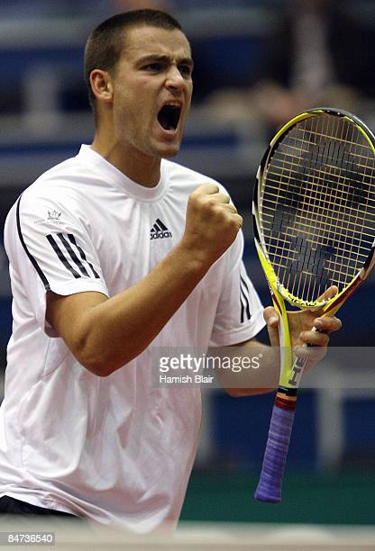 Mikhail Youzhny of Russia celebrates a break of serve during his match against David Ferrer of Spain during day three of the ABN AMRO World Tennis...