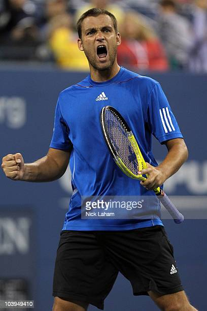 Mikhail Youzhny of Russia celebrates a point against Stanislas Wawrinka of Switzerland during his men's single quarterfinal match on day eleven of...
