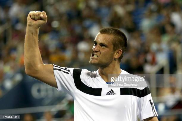 Mikhail Youzhny of Russia celebrates a point against Tommy Haas of Germany during their third round match on Day Seven of the 2013 US Open at USTA...