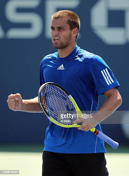 Mikhail Youzhny of Russia celebrates after a point against Tommy Robredo of Spain during his men's singles fourth round match on day nine of the 2010...