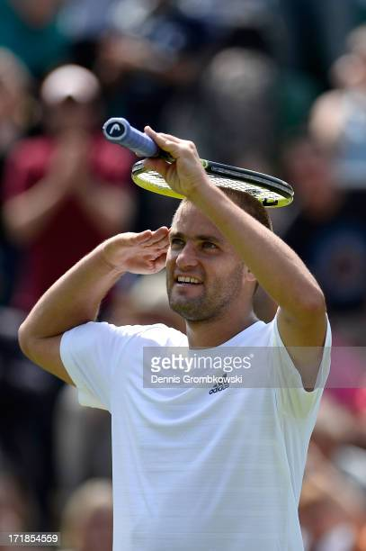 Mikhail Youzhny of Russia celebrates match point during his Gentlemen's Singles third round match against Viktor Troicki of Serbia on day six of the...