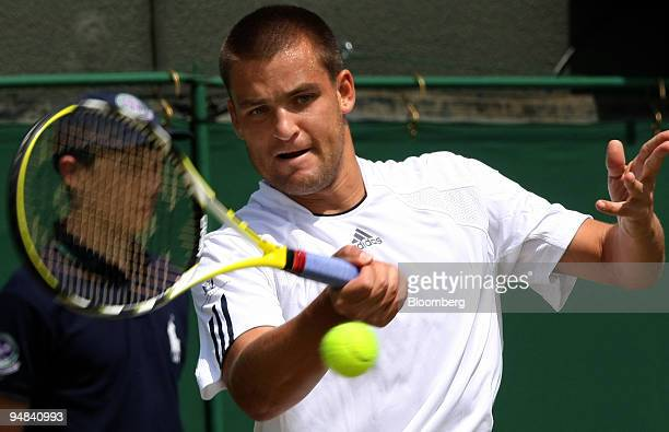 Mikhail Youzhny of Russia makes a return to Stefano Galvani of Italy unseen in their match at the Wimbledon tennis championships in southwest London...