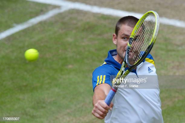 Mikhail Youzhny of Russia play a backhand in the final match against Roger Federer of Switzerland during the final day of the Gerry Weber Open at...