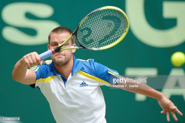 Mikhail Youzhny of Russia play a forehand in the final match against Roger Federer of Switzerland during the final day of the Gerry Weber Open at...