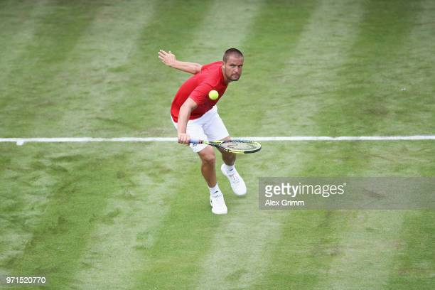 Mikhail Youzhny of Russia plays a backhand to Mischa Zverev of Germany during day 1 of the Mercedes Cup at Tennisclub Weissenhof on June 11 2018 in...