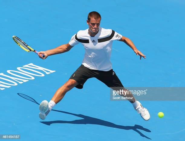 Mikhail Youzhny of Russia plays a forehand during his match against Jordan Thompson of Australia during day two of the AAMI Classic at Kooyong on...