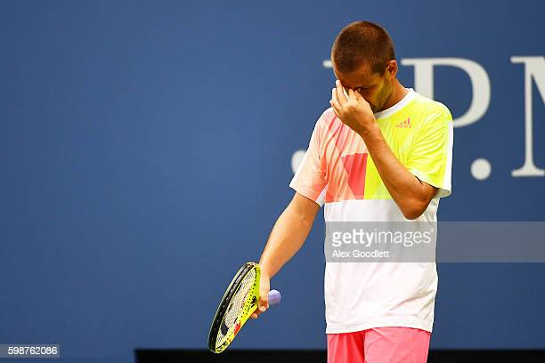 Mikhail Youzhny of Russia reacts against Novak Djokovic of Serbia during his third round Men's Singles match on Day Five of the 2016 US Open at the...