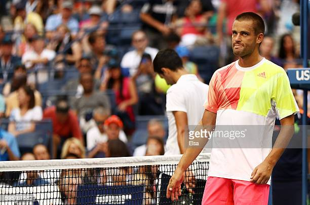 Mikhail Youzhny of Russia retires to Novak Djokovic of Serbia during his third round Men's Singles match on Day Five of the 2016 US Open at the USTA...