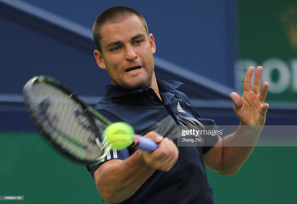 Mikhail Youzhny of Russia returns a shot during the Men's Singles Quarterfinal match against Feliciano Lopez of Spain during the day 6 of the Shanghai Rolex Masters at the Qi Zhong Tennis Center on October 10, 2014 in Shanghai, China.