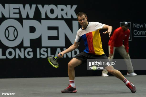 Mikhail Youzhny of Russia returns ball during 2nd round match against Sam Querrey of USA at ATP 250 New York Open tournament at Nassau Coliseum