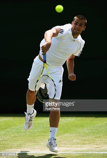 Mikhail Youzhny of Russia serves during the round two men's singles match against Stefano Galvani of Italy on day four of the Wimbledon Lawn Tennis...