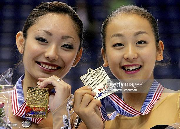 Miki Ando and Mao Asada of Japan pose for photographers after the medal ceremony for the the ladies competition during Skate America October 28 2006...