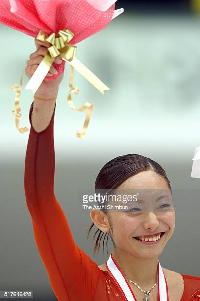 Miki Ando celebrates winning the Women's Singles during day three of the All Japan Junior Figure Skating Championships at Kyoto Aquarena on November...