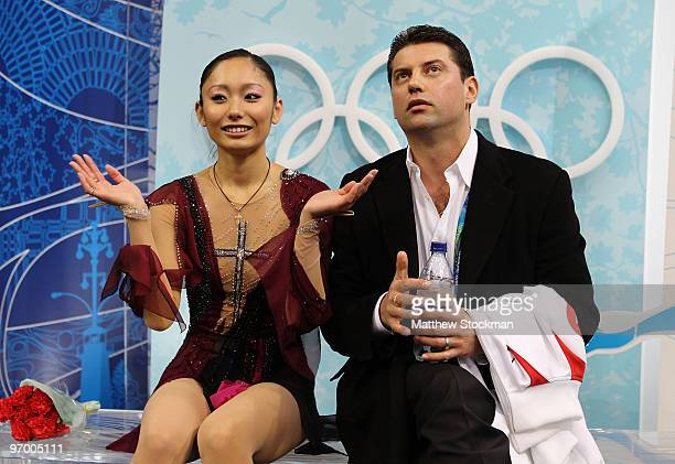Miki Ando of Japan accompanied by her coach Nikolai Morozov reacts after competing in the Ladies Short Program Figure Skating on day 12 of the 2010...