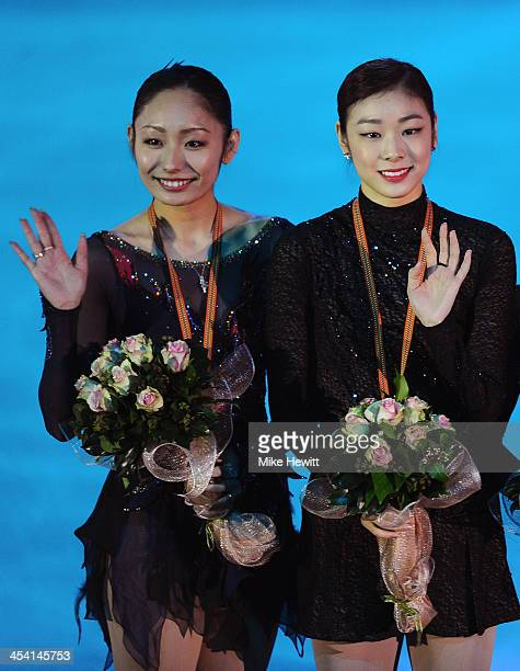 Miki Ando of Japan and Yuna Kim of Republic of Korea celebrate during the Medal Ceremony for the Ladies Free Skating during Day Three of the ISU 46th...