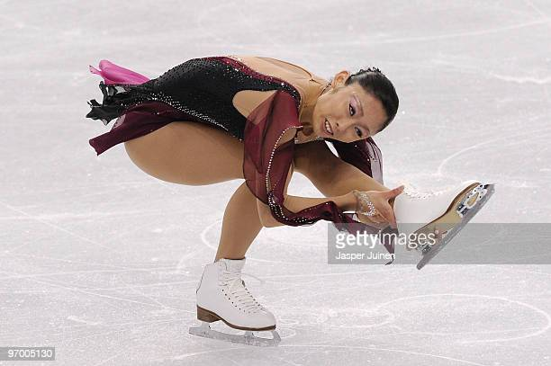 Miki Ando of Japan competes in the Ladies Short Program Figure Skating on day 12 of the 2010 Vancouver Winter Olympics at Pacific Coliseum on...